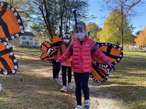 Students outside dressed as butterflies